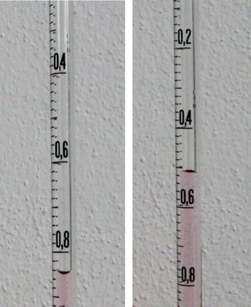 The water level in the graduated pipette at the beginning and end of the experiment, showing a volume increase